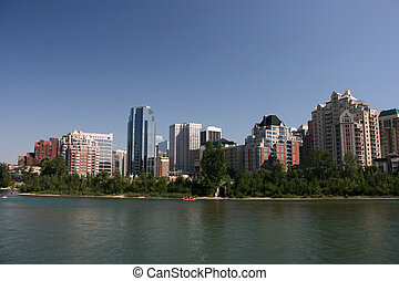 Calgary downtown skyline with Bow River. Modern skyscrapers...