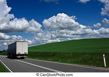 Truck on the road - Weath cereal field in denmark in the...