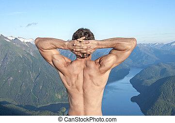 Enjoying the view - Back of shirtless muscular Caucasian man...