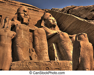 Statues at the entrance to the Abu Simbel Temple (Egypt) -...
