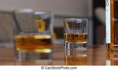whiskey in glass and bottle - rack focus