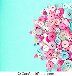 Collection of Colourful Sewing Buttons on Retro Turquiose...