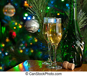 Christmas Cheer - Two glasses and bottle of champagne in...