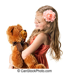 Little girl with teddy bear isolated on white background