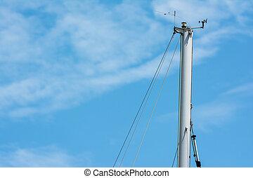 Yacht Flagpole Closeup On Blue Sky