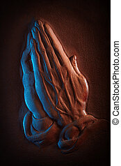 Praying hands - Leather sculpted in the shape of praying...