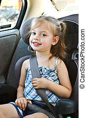 Child in car seat - Little girl in a car seat smiling at...