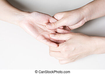 Finger base ventral to massage - Woman hand finger base...