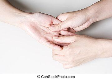 Finger base ventral to massage - Woman hand finger base...