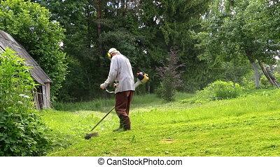Gardener trimmer grass - Gardener man cut grass with trimmer...