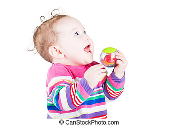 Sweet baby girl playing with a ball, isolated on white