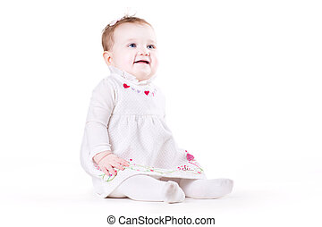 Cute baby girl in a white dress