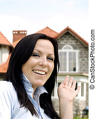 smiling woman showing the new house