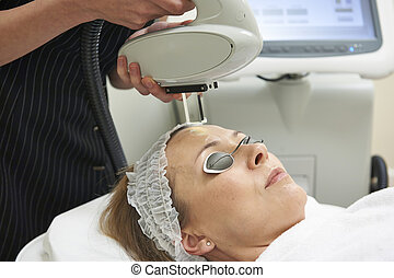 Beautician Carrying Out Intense Pulse Light Treatment