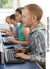 Group Of Elementary School Children In Computer Class