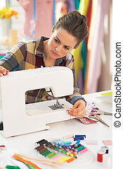 Tailor woman working with sewing machine