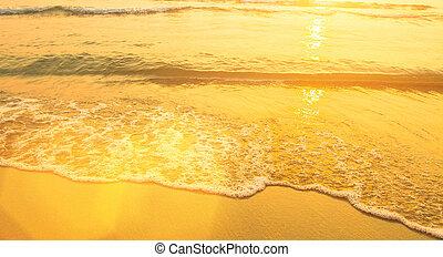 Beach sand texture. Soft wave of the sea.