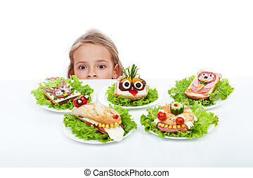 Little girl looking at creative food creatures - craving the...