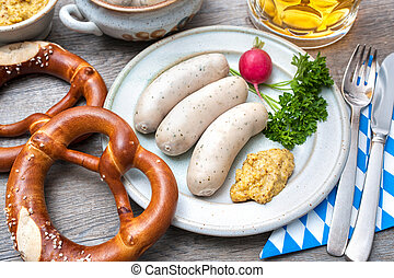 Bavarian meal White sausages with sweet mustard and pretzels...