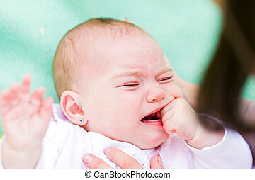 Crying baby - Portrait of a crying baby because she is...