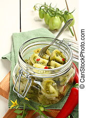 Homemade green tomatoes preserves in glass jar