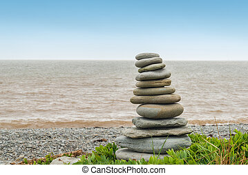 Stone sculpture Inukshuk Cape Enrage, New Brunswick, Canada...