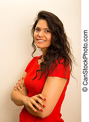 young latina woman posing with crossed arms.