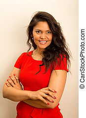 happy young latina posing with crossed arms.