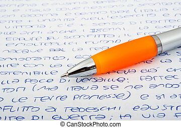Pen with letters - Orange ballpen on a letters background