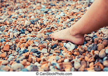 The foot of a young woman on the beach - The foot of a young...