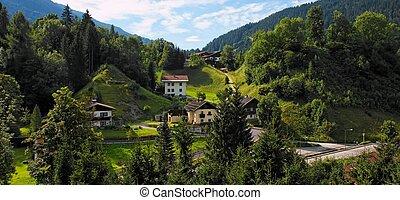 Alpine village under the mountains at sunrise