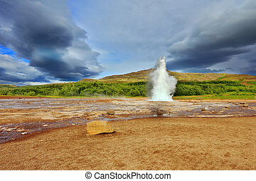 Geyser Strokkur erupts every few minutes Famous geyser...
