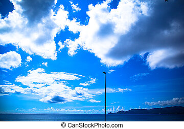 Blue sky with clouds, background