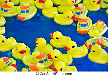 rubber ducks in wading pool - Rubber yellow ducks and boats...