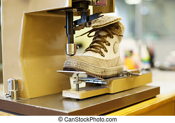 Manufacturing of brown demi-season boots - Production of...