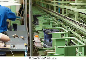 Production of blue demi-season boots on rubber soles