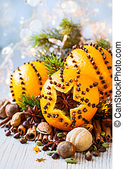 Christmas oranges,spices and nuts - Oranges pierced with...