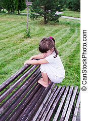 child playing on the grass