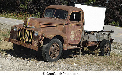 Old Truck with Sign - Vintage American Truck parked in a...
