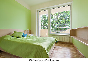 Green bedroom in apartment - Horizontal view of green...