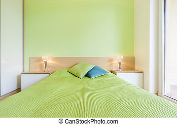 Interior of bedroom with green wall, horizontal