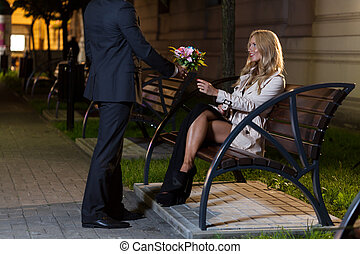 Man with flowers for woman