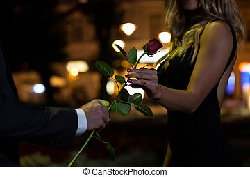 Woman getting rose on first date - Woman getting rose on the...