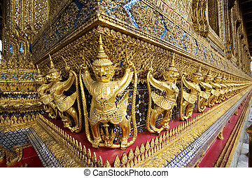 Thailand - Gold ornamental patter statuettes Temple of the...