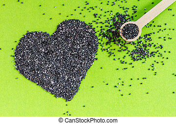 Black and White Chia Seeds - Black chia seeds arranged in...