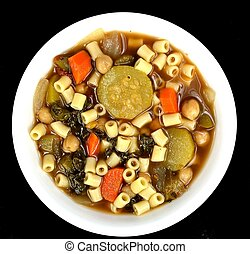 Minestrone soup - White bowl of minestrone soup on a black...