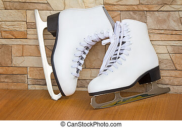 The female skates and boots of white color for figure...