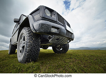 Offroad car in the mountains - A black offroad all terrain...
