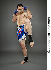 Kickboxer in guard stance - Kickbox or muay thai fighter in...
