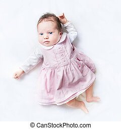 Little newborn baby girl wearing her first dress